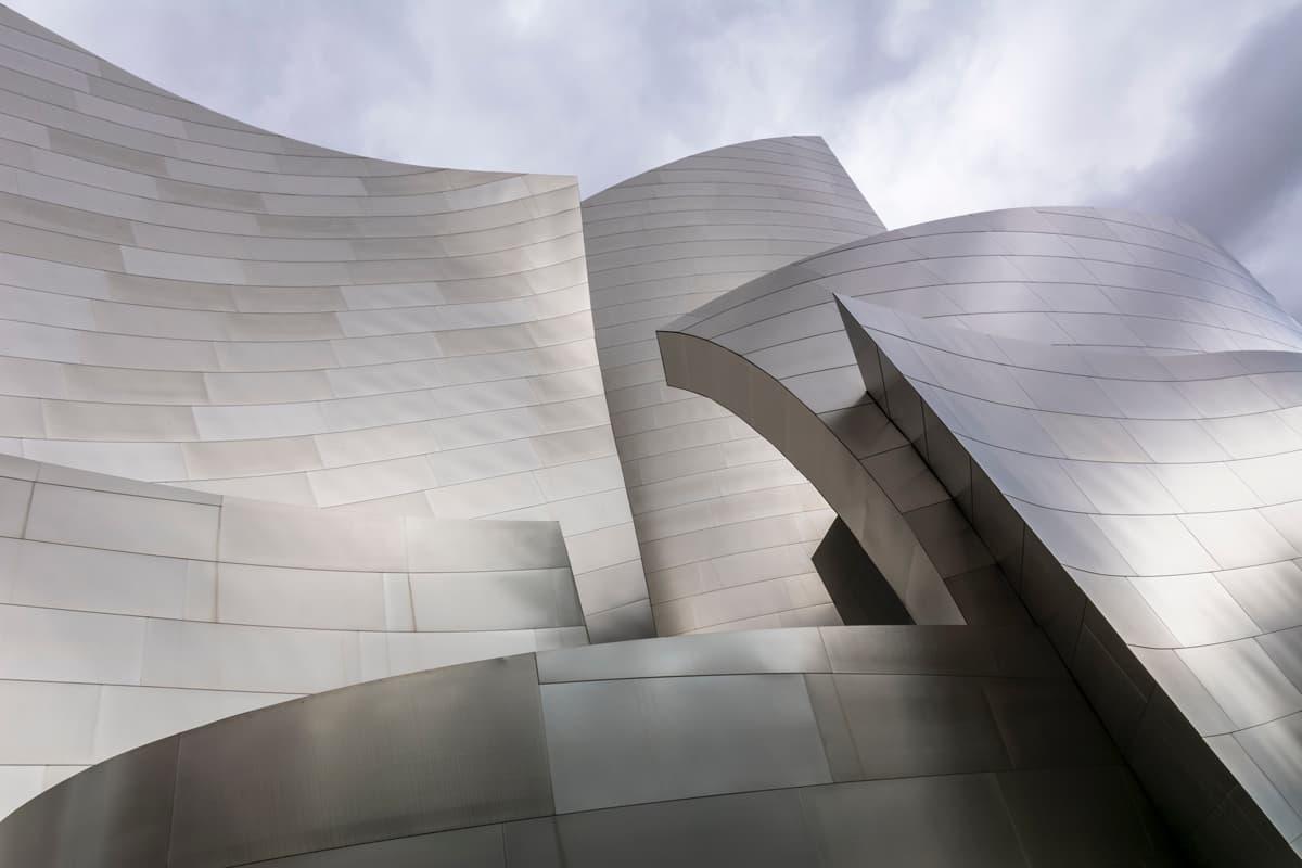 Metal facade cladding material